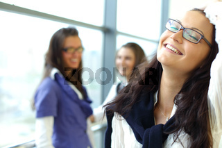 Student meeting smiley girl face on foreground