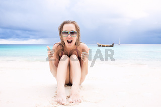 Happy woman on the beach