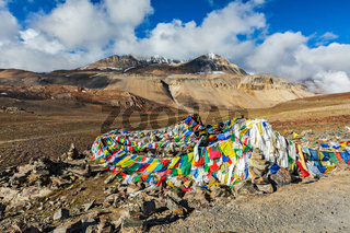Buddhist prayer flags (lungta) on Baralacha La pass in Himalayas