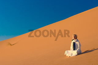 The woman relaxation in Sahara