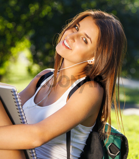 Happy young student outdoors