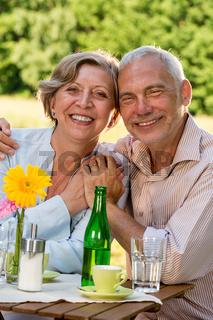 Cheerful senior couple smiling at camera