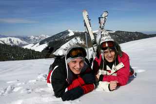 Young couple laying in the snow