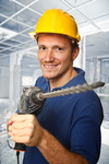 worker with electric drill