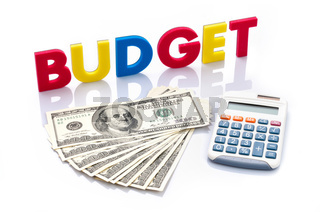 Budget words, American banknotes and calculator