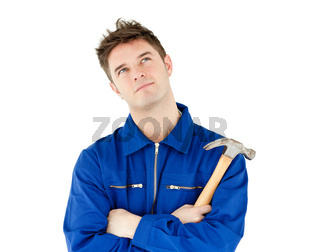Thoughtful male worker holding a hammer