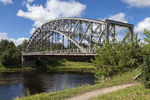 Steel Arch Bridge on river Msta. Novgorod region, Russia