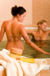 Spa beauty products two naked women pool