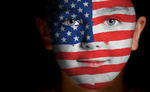 Portrait of a child with a painted American flag
