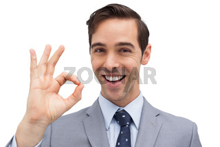 Successful businessman giving ok sign