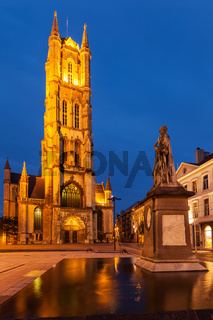 Monument to Jan Frans Willems and Saint Bavo Cathedral in the evening. Sint-Baafsplein
