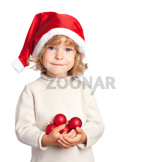 Smiling child in Santa hat with Christmas balls on white background