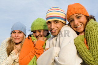 group of kids huddled against winter cold