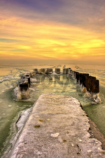 The Sea pier covered ice at sunset