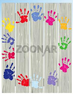Kinderhand auf Zaun.jpg