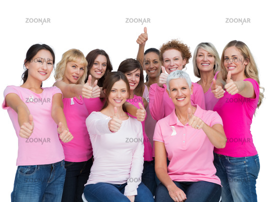 Cheerful women posing and wearing pink for breast cancer
