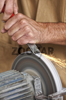 manual worker sharp his tool