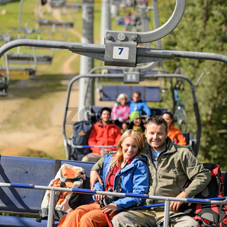 Couple hugging on romantic chairlift trip