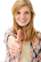 Young smiling girl showing thumbs up