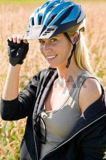Sportive young woman bike helmet sunny outdoor