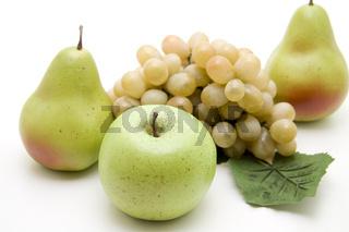 Grüner Apfel mit Trauben