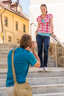 Young couple in city take photos