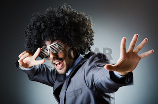 Man with afro haircut singing in studio