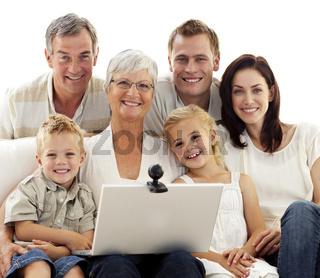 Happy family using a laptop at home