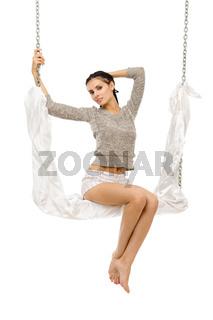 Beautiful woman swinging on a swing.