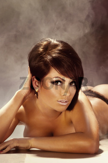 Amazing young brunette lady with short hair looking at camera.
