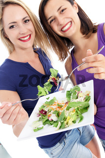 Health conscious women enjoying salad
