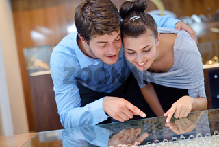 happy young couple in jewelry store