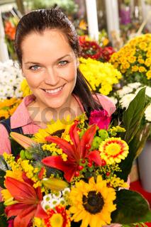 Smiling florist woman colorful bouquet flower market