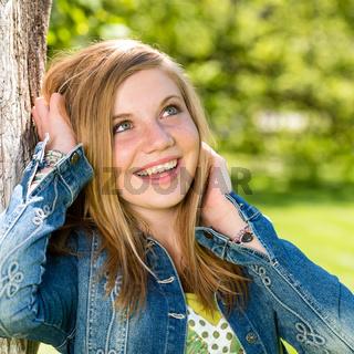 Lively smiling girl enjoying nature and sunshine