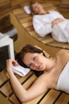 Relax spa woman lying on wooden chair