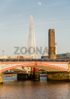 Underneath Blackfriars Bridge in London with boat