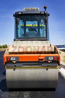 compactor at asphalt pavement works (road repairing)