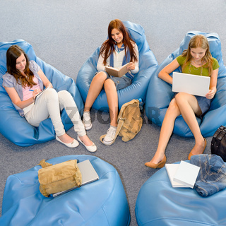Group of students relax on beanbag