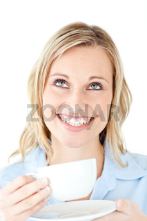 Cheerful businesswoman holding a cup of coffee against a white background
