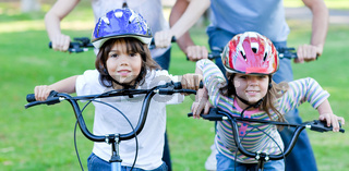 Jolly children riding a bike