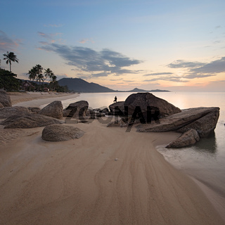 Sunrise at rocky coast of Lamai beach