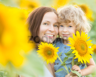 Happy family with beautiful sunflowers