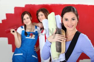 Three women home decorating