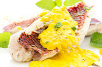 Goatfish fillet with saffron cream sauce