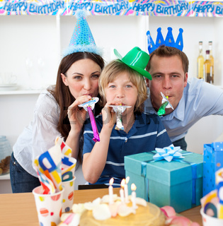 Jolly parents celebrating their son's birthday