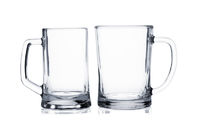 Two empty beer mugs on white