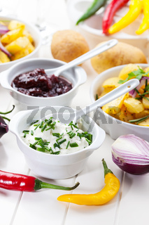 Sour cream and chutney with baked potatoes