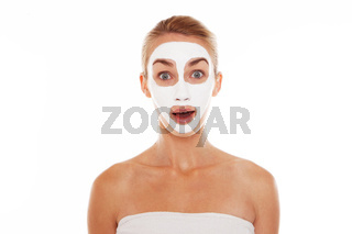 Woman in face mask with surprised expression