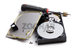 dismanteled hard disk and screwdriver