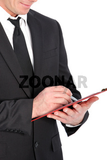Close-up of a business man with clipboard and pen